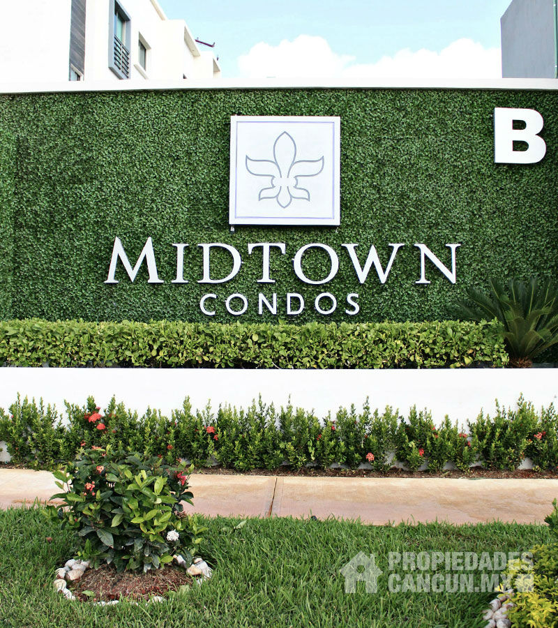 sala_tv_departamento_midtown_condos_long_island_cancun_midof24